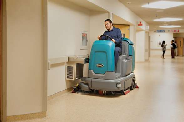 Tennant T12 Compact Industrial Ride On Scrubber Powervac